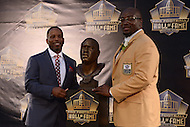 Canton, Ohio - August 8, 2015: Former NFL player Will Shields (r) and friend Adrian Lunsford pose with Shield's bust bust during the 2015 Pro Football Hall of Fame enshrinement in Canton, Ohio, August 8, 2015. During his 14-season career, Shields started every game, never missed a game and earned 12 straight Pro Bowl berths.  (Photo by Don Baxter/Media Images International)