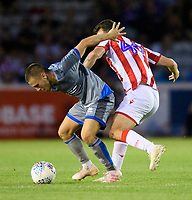 Lincoln City's Jack Payne vies for possession with Stoke City's Jack Dunwoody<br /> <br /> Photographer Chris Vaughan/CameraSport<br /> <br /> Football Pre-Season Friendly - Lincoln City v Stoke City - Wednesday July 24th 2019 - Sincil Bank - Lincoln<br /> <br /> World Copyright © 2019 CameraSport. All rights reserved. 43 Linden Ave. Countesthorpe. Leicester. England. LE8 5PG - Tel: +44 (0) 116 277 4147 - admin@camerasport.com - www.camerasport.com