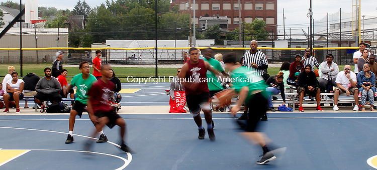 WATERBURY, CT - 29 JULY 2017 - 072917JW13.jpg -- Spectators watch one of the many games during the Hoop to Help basketball Tournament Saturday afternoon at the Waterbury Police Athletic League. Funds raised from the event hosted by the Community Tabernacle Outreach Center, will go to buying book bags and school supplies to anyone who needs them to be distributed Aug. 20th at the Community Tabernacle Outreach Center.  Jonathan Wilcox Republican-American