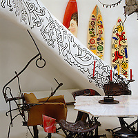 The curved staircase balustrade decorated by Keith Haring adds to the eclectic collection of modern art inside Niki de Saint Phalle's sculptural house