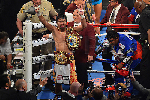 09.04.2016, Las Vegas, Nevada, USA. Manny Pacquiao (Philippines) raises his arms in victory after the Pacquiao versus Bradley Welterweight Championship fight in the MGM Grand Garden Arena at the MGM Grand Hotel and Casino in Las Vegas, Nevada. Manny Pacquiao (Philippines) defeated Timothy Bradley, Jr. (USA) by unanimous decision.