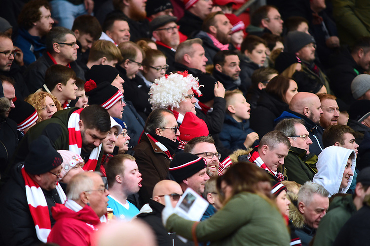 Lincoln City fans watch their team in action<br /> <br /> Photographer Andrew Vaughan/CameraSport<br /> <br /> The EFL Sky Bet League Two - Lincoln City v Mansfield Town - Saturday 24th November 2018 - Sincil Bank - Lincoln<br /> <br /> World Copyright © 2018 CameraSport. All rights reserved. 43 Linden Ave. Countesthorpe. Leicester. England. LE8 5PG - Tel: +44 (0) 116 277 4147 - admin@camerasport.com - www.camerasport.com