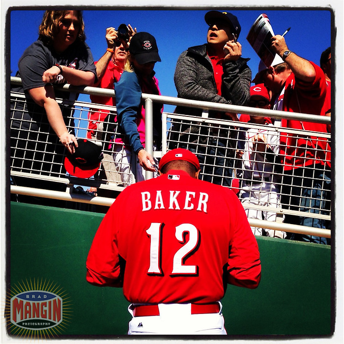 SCOTTSDALE, AZ - FEBRUARY 23:  Instagram of Reds manager Dusty Baker signing autographs before the spring training game between the Cleveland Indians and Cincinnati Reds on February 23, 2013 in Goodyear, Arizona. Photo by Brad Mangin