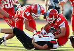 SIOUX FALLS, SD - SEPTEMBER 26: Dalton Jones #43 and Ethan Schilling #33 from Lincoln bring down Carter Gordon #12 from Brookings in the first half of their game Friday night at Howard Wood Field. (Photo by Dave Eggen/Inertia)