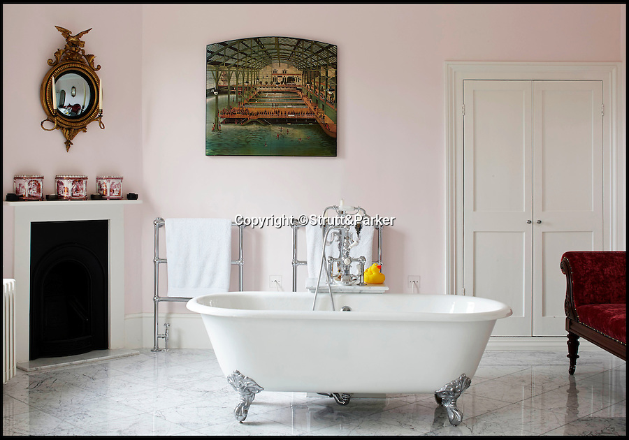 BNPS.co.uk (01202 558833)<br /> Pic: Strutt&Parker/BNPS<br /> <br /> One of the bathrooms.<br /> <br /> A striking Georgian manor house that once hosted the scandalous menage-a-trois of Admiral Horatio Lord Nelson, his lover and her husband is on the market for £4.25million.<br /> <br /> The love triangle stayed at the property a couple of times in about 1801-1802, when Lord Nelson and Lady Emma Hamilton were two of the most famous people in the UK.<br /> <br /> Fir Hill was bought by the admiral's friend and colleague Captain Charles Powell Hamilton, who was also the cousin of Emma's husband Sir William Hamilton, in 1797.<br /> <br /> The house is in a picturesque spot in the South Downs National Park, at the heart of the Meon Valley in the village of Droxford, Hants.