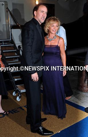 "NICOLAS CAGE AND ALBERTA FERRETTI.Alberta Ferretti's Party, Venice_04/09/2009.Mandatory Credit Photo: ©NEWSPIX INTERNATIONAL..**ALL FEES PAYABLE TO: ""NEWSPIX INTERNATIONAL""**..IMMEDIATE CONFIRMATION OF USAGE REQUIRED:.Newspix International, 31 Chinnery Hill, Bishop's Stortford, ENGLAND CM23 3PS.Tel:+441279 324672  ; Fax: +441279656877.Mobile:  07775681153.e-mail: info@newspixinternational.co.uk"