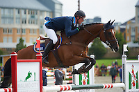 Niklas Lindback (SWE) and Mister Pooh during the show jumping test. Malmo City Horse Show FEI World Cup Eventing Qualifier CIC***. <br /> The couple was placed 5th after Friday's dressage, 3rd after Saturday's cross country and finished after the show jumping as the winner.<br /> At the Swedish Championships (a competition-in-the-competition) the couple was placed 2nd after Friday's dressage, 1st after Saturday's cross country and won during Sunday's show jumping.<br /> Eventing in Ribersborg, Malmo, Sweden.<br /> August 2011.<br /> Only for editorial use.