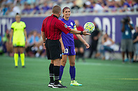 Orlando, Florida - Sunday, May 8, 2016: Orlando Pride forward Alex Morgan (13) and the referee have a laugh before a drop ball during a National Women's Soccer League match between Orlando Pride and Seattle Reign FC at Camping World Stadium.