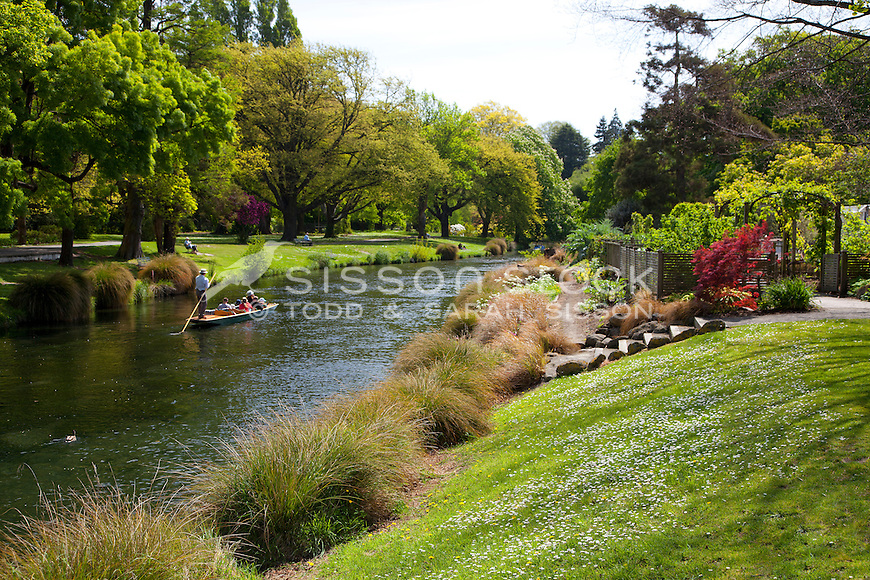 Tourists are punted down the Avon River through Hagley Park in Christchurch
