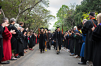 Professors Marcella Raney and Andrew Jalil lead the graduates<br />