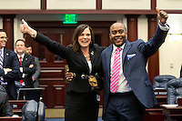 TALLAHASSEE, FLA. 5/3/13-SESSIONEND050313CH-Rep. Dana Young, R-Tampa, left, and Rep. Alan B. Williams, D-Tallahassee, right celebrate the passage of the bill designed to fix the problems that plagued the 2012 election process during the final day of the legislative session May 3, 2013 at the Capitol in Tallahassee...COLIN HACKLEY PHOTO