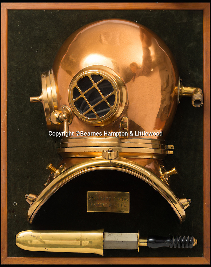 BNPS.co.uk (01202 558833)<br /> Pic: BHandI/BNPS<br /> <br /> A display mounted half section 6-bolt 'Pearler' diving helmet and divers knifes.<br /> <br /> A British couple's lifetime hobby of deep sea diving is set to make them a breathtaking £500,000 when they sell one of the world's finest collection of vintage diving helmets.<br /> <br /> Anthony and Yvonne Pardoe amassed over 150 heavyweight copper helmets worn by divers during the early days of underwater excavation.<br /> <br /> Weighing about 55lbs, the dome-shaped helmets bolted onto a copper collar of a diving suit and had a hose attached to the rear to provide air supply from the surface.<br /> <br /> They are being sold in Devon next month.