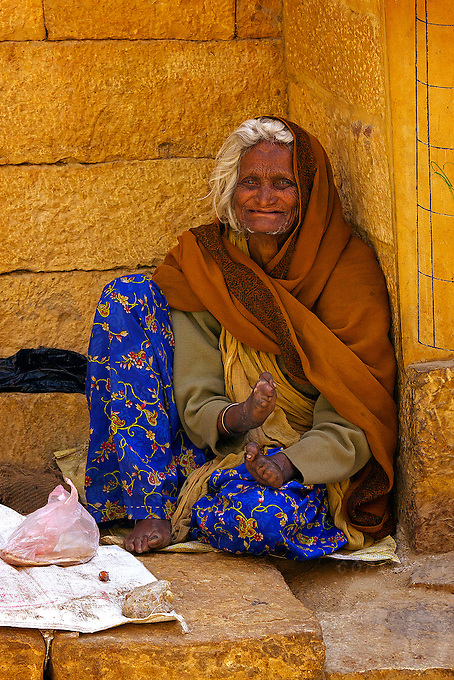 """Jaisalmer, the """"Golden City,"""" is located on the westernmost frontier of India in the state of Rajasthan. Close to the Pakistan border, the city is known for its proximity to the Thar Desert.<br /> <br /> The city is dominated by the Jaisalmer Fort, also known as Sonar Qila (Golden Fort). Unlike most forts in India, the Jaisalmer Fort is a living fort. There are shops, hotels and age old havelis (homes) inside the fort area where families have lived for generations."""