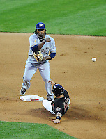 May 8, 2010; Phoenix, AZ, USA; Milwaukee Brewers second baseman Rickie Weeks throws to first base to complete the double play after forcing out Arizona Diamondbacks base runner Augie Ojeda in the fifth inning at Chase Field. Mandatory Credit: Mark J. Rebilas-