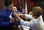 Nevada Sen. Shirley Breeden, D-Henderson, helps straighten her grandson's tie during opening day ceremonies at the Legislature in Carson City, Nev. on Monday, Feb. 7, 2011. Breeden's son-in-law Elliott Kleven and grandson Kade, 5 months, were among hundreds of friends and family members in attendence. .Photo by Cathleen Allison