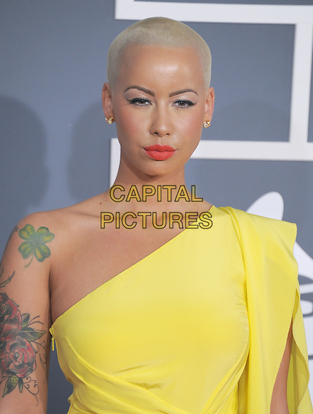 Amber Rose.The 54th Annual GRAMMY Awards held at The Staples Center in Los Angeles, California, USA..February 12th, 2012.headshot portrait yellow one shoulder four leaf clover.CAP/RKE/DVS.©DVS/RockinExposures/Capital Pictures.