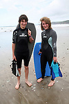 Model Released picture of teenage boy girl twins in wetsuits on beach, Newgale Sands, Pembrokeshire, Wales, UK