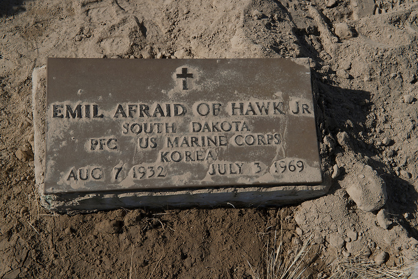 The grave of Emil Afraid of Hawks Jr, veteran from the Korean war at the Wounded Knee cemetery.