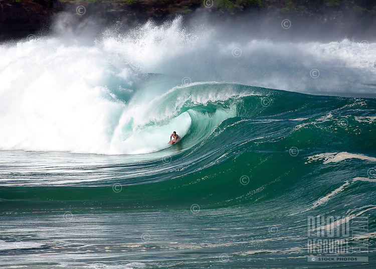 A body boarder gets barrelled on a big wave at Waimea Shorebreak in Waimea Bay on the North Shore of O'ahu