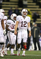 Oct 30, 20010:  Stanford quarterback #12 Andrew Luck looks to the sidelines for the play to be signaled in against Washington.  Stanford defeated Washington 41-0 at Husky Stadium in Seattle, Washington...