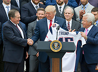 United States President Donald J. Trump, center, shakes hands with head coach Bill Belichick, left, as he and New England Patriots owner Robert Kraft, right, hold up the Super Bowl LI jersey as the President welcomes the Super Bowl Champions to the South Lawn of White House in Washington, DC on Wednesday, April 19, 2917.<br /> Credit: Ron Sachs / CNP/MediaPunch<br /> <br /> (RESTRICTION: NO New York or New Jersey Newspapers or newspapers within a 75 mile radius of New York City)