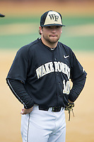 Wake Forest Demon Deacons second baseman Nate Mondou (10) waits to take the field between innings of the game against the Towson Tigers at Wake Forest Baseball Park on March 1, 2015 in Winston-Salem, North Carolina.  The Demon Deacons defeated the Tigers 15-8.  (Brian Westerholt/Four Seam Images)