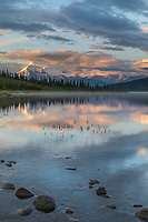 Early morning sunlight shines on Mt. Brooks and the Alaska Range by Wonder Lake, Denali National Park, Alaska.