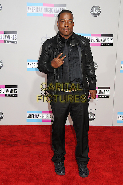 Won-G.2011 American Music Awards - Arrivals held at Nokia Theatre LA Live, Los Angeles, California, USA..November 20th, 2011.ama amas ama's full length black leather jacket shirt trousers hand v peace sign rude gesture.CAP/ADM/BP.©Byron Purvis/AdMedia/Capital Pictures.