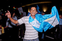 A man holds an Argentinian flag while he attends a protest against the policies government of Argentina's President Cristina Fernandez in Buenos Aires April 18, 2013. Photo by Juan Gabriel Lopera / VIEWpress.