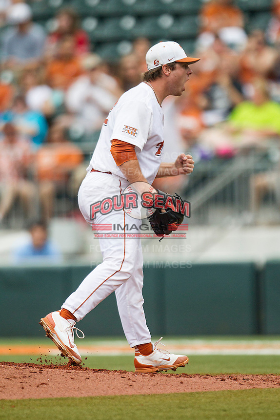 Texas Longhorns pitcher Dillon Peters #32 reacts after recording the final out of the second inning in the NCAA baseball game against the Oklahoma State Cowboys on April 26, 2014 at UFCU Disch–Falk Field in Austin, Texas. The Cowboys defeated the Longhorns 2-1. (Andrew Woolley/Four Seam Images)