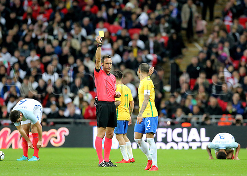 14th November 2017, Wembley Stadium, London, England; International football friendly, England versus Brazil; Dani Alves of Brazil receives a yellow card off Referee Artur Manuel Ribeiro Soares Dias for rough challenge on Ryan Bertrand of England