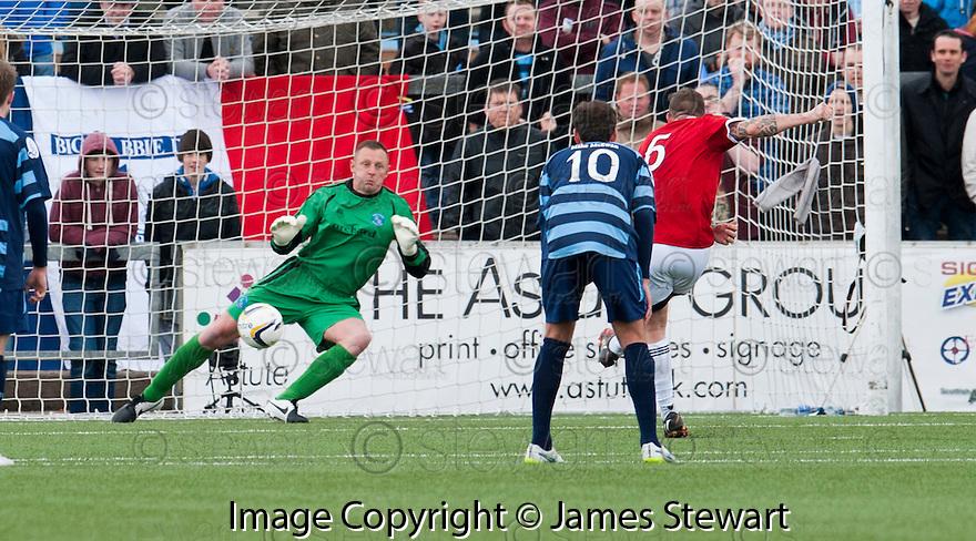 Ayr Utd's Jon Paul McGovern scores their first goal from the spot.