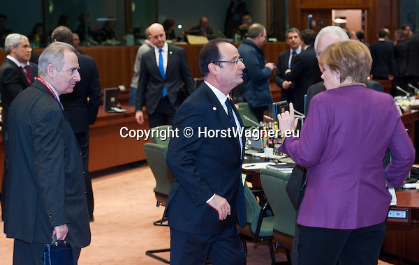 Brussels-Belgium - March 15, 2013 -- European Council, EU-summit meeting of Heads of State / Government; here, Francois (François) HOLLANDE (ce), President of France, and Angela MERKEL (ri), Federal Chancellor of Germany -- Photo: © HorstWagner.eu