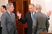 United States Senate Minority Leader Chuck Schumer (Democrat of New York), center, engages in conversation with US House Majority Leader Kevin McCarthy (Republican of California), left, and US Senate Majority Leader Mitch McConnell (Republican of Kentucky), right, prior to the arrival of President Donald Trump at a reception for US House and US Senate Republican and Democratic leaders in the State Dining Room of the White House in Washington, DC on Monday, January 23, 2017.<br /> Credit: Ron Sachs / Pool via CNP