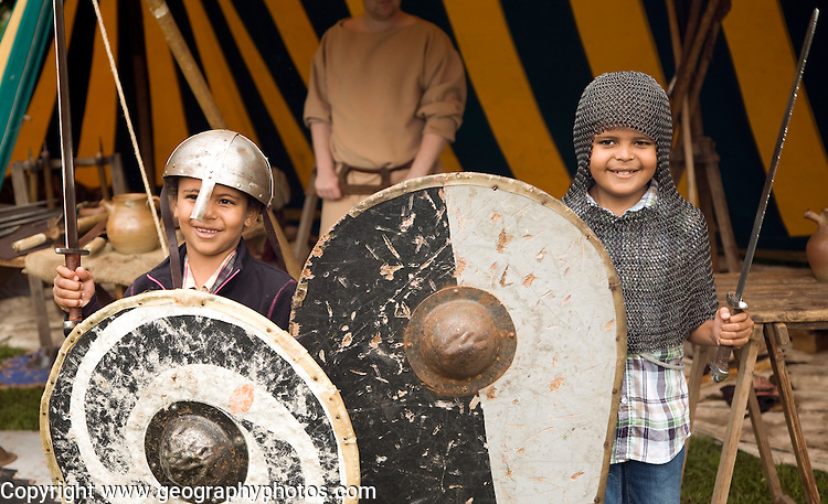 Two boys dressed as soldiers Historical re-enactment Saxon, Viking, Norman history, Woodbridge, Suffolk