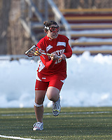 Boston University attacker Jenna Boarman (18)..Boston College (white) defeated Boston University (red), 12-9, on the Newton Campus Lacrosse Field at Boston College, on March 20, 2013.