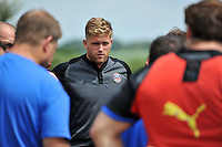 Ben Williams looks on in a huddle. Bath Rugby pre-season training session on July 18, 2014 at Farleigh House in Bath, England. Photo by: Patrick Khachfe/Onside Images