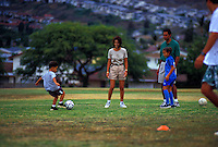 Family playing soccer at a park in Hawaii Kai, Oahu