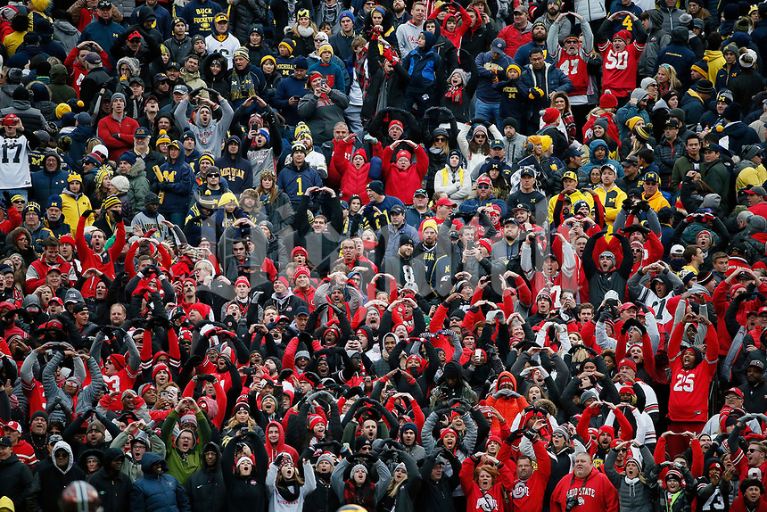 """Ohio State Buckeyes fans chant the """"O"""" during the O-H-I-O against Michigan Wolverines during the 2nd half of their game at Michigan Stadium on November 25, 2017.  [Kyle Robertson\ Dispatch]"""