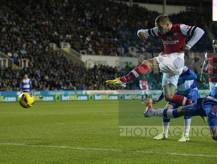 Arsenal's Lukas Podolski scoring his sides opening goal..Reading v  Arsenal - Premier League - Madejski Stadium, Reading- 17/12/12 - Picture David Klein/Sportimage
