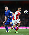 Arsenal's Alexis Sanchez tussles with Leicester's Robert Huth during the Premier League match at the Emirates Stadium, London. Picture date: April 26th, 2017. Pic credit should read: David Klein/Sportimage