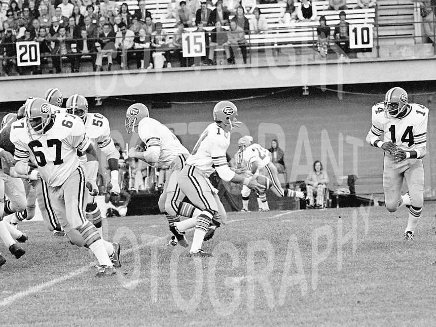 Roy Bell(14) and Bruce Lemmerman quarterback Edmonton Eskimos 1973. Copyright photograph Scott Grant