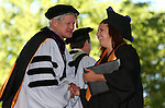 Regent Ron Knecht congratulates graduate Sarah Drinkwine at the 2013 Western Nevada College Commencement at the Pony Express Pavilion, in Carson City, Nev., on Monday, May 20, 2013. .Photo by Cathleen Allison