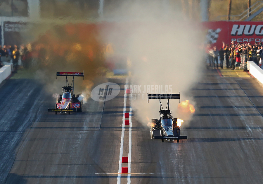 Feb 23, 2019; Chandler, AZ, USA; NHRA top fuel driver Mike Salinas (right) races alongside Brittany Force during qualifying for the Arizona Nationals at Wild Horse Pass Motorsports Park. Mandatory Credit: Mark J. Rebilas-USA TODAY Sports