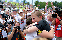 Maryland head coach Cathy Reese hugs goalie and MVP Megan Taylor (34) after winning the national championship after the Maryland Terrapins vs. the Boston College Eagles in the 2019 NCAA Division I Women's Lacrosse National Championship Game May 26, 2019 at Homewood Field at Johns Hopkins University in Baltimore, MD.