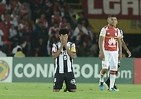 BOGOTÁ-COLOMBIA-18-03-2015: Edcarlos jugador de Mineiro ora tras la vicroria de su equipo en el encuentro entre Independiente Santa Fe de Colombia y Atletico Mineiro de Brasil por la segunda fase grupo 1, de la Copa Bridgestone Libertadores en el estadio Nemesio Camacho El Campin, de la ciudad de Bogota. / Edcarlos player of Mineiro prays after the victory of his team on the  match between Independiente Santa Fe and Atletico Mineiro of Brasil for the second phase, group 1, of the Copa Bridgestone Libertadores in the Nemesio Camacho El Campin in Bogota city.  Photo: VizzorImage/ Gabriel Aponte /Staff