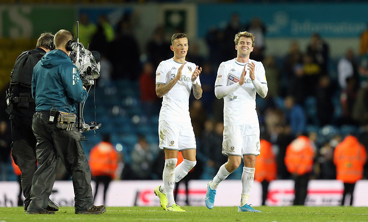 Leeds United's Ben White (left) and Patrick Bamford applaud the fans at the final whistle<br /> <br /> Photographer Rich Linley/CameraSport<br /> <br /> The EFL Sky Bet Championship - Tuesday 1st October 2019  - Leeds United v West Bromwich Albion - Elland Road - Leeds<br /> <br /> World Copyright © 2019 CameraSport. All rights reserved. 43 Linden Ave. Countesthorpe. Leicester. England. LE8 5PG - Tel: +44 (0) 116 277 4147 - admin@camerasport.com - www.camerasport.com
