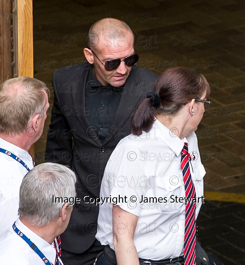 Former boxing champ Scott Harrison is released from Edinburgh Sheriff Court through a side door and gets into a waiting taxi with his parents already inside.