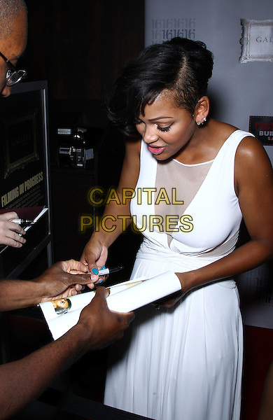 Meagan Good.Meagan Good performs at Pussycat Dolls Burlesque Saloon inside Planet Hollywood Casino resort, Vegas, Las Vegas, Nevada, USA, .25th May 2012..half length white sheer dress cleavage sleeveless signing autographs .CAP/ADM/MJT.© MJT/AdMedia/Capital Pictures.