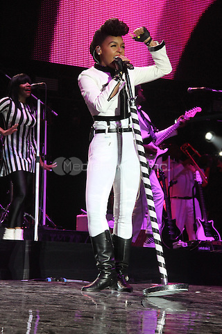 NEW ORLEANS, LA - JULY 4: Janelle Monee performs at the 20th Anniversary of the Essence Festival at the Mercedes Benz Superdome, July 4, 2014 in New orleans, Louisiana. Credit: Walik Goshorn/MediaPunch